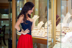 A woman is in the jewelry store. A beautiful woman is in the jewelry store stock photo