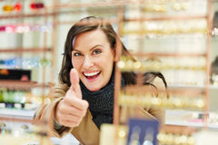 Woman at jewelry store holding Stock Photos