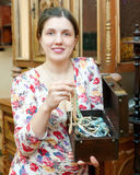 Woman with jewelry in treasure chest Stock Photo