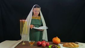 A woman of the Jews reads a prayer in honor of Rosh Hashanah. Overall plan stock footage