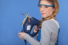 Woman with a jigsaw Royalty Free Stock Photography