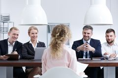Woman on job interview. Young women sitting in front of staff on job interview Royalty Free Stock Image