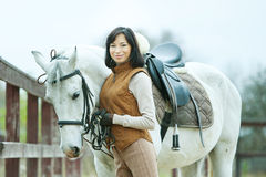 Woman jockey. Is riding the horse outdoor stock photography