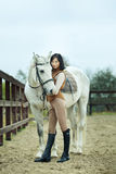 Woman jockey. Is riding the horse outdoor stock image