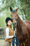 Woman jockey. Is riding the horse outdoor royalty free stock image