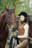 Woman jockey Stock Photo