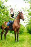 Woman jockey training riding horse. Sport activity Royalty Free Stock Photo