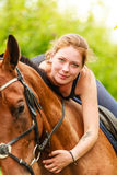 Woman jockey training riding horse. Sport activity Stock Image