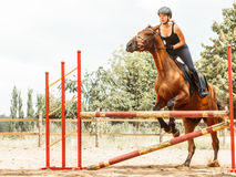 Woman jockey training riding horse. Sport activity Royalty Free Stock Images