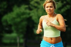 Woman Jogger. Beautiful girl jogging on a summer day stock images