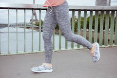 Woman jogger against clear view of Eiffel Tower running. Active woman jogger in sport clothes running against clear view of the Eiffel Tower in Paris, France stock photography