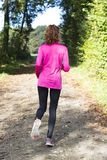 Woman jogger outside in forest Royalty Free Stock Image