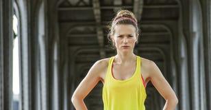 Woman jogger standing on Pont de Bir-Hakeim bridge in Paris Royalty Free Stock Images
