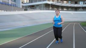 Woman jogger using fitness bracelet during running