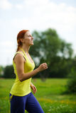 Woman jogging Royalty Free Stock Images