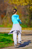 Woman jogging. In the park in autumn stock photo