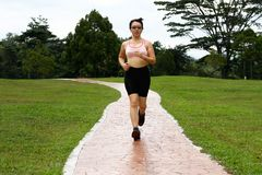 Woman Jogging Royalty Free Stock Photos