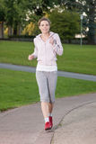 Woman is jogging Royalty Free Stock Photography