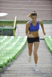 Woman Jogging At Athletics Stadium Stock Photography