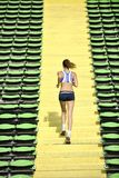 Woman jogging at athletics stadium Stock Image