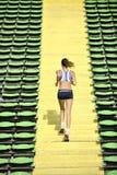 Woman jogging at athletics stadium Stock Image