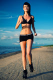 Woman jogging on the beach Royalty Free Stock Photos