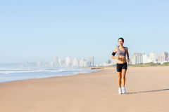 Woman jogging beach Stock Photo