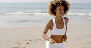 Woman Jogging On The Beach Royalty Free Stock Images