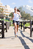 Woman jogging beach Royalty Free Stock Image