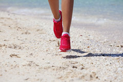 Woman jogging on beach Royalty Free Stock Photography