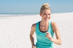 Woman jogging at beach Royalty Free Stock Photography