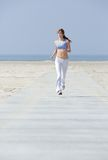 Woman jogging at the beach Royalty Free Stock Photography