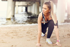 Woman jogging on the beach stock photos