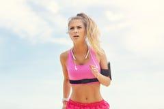 Woman jogging on the beach Stock Photo