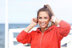 Woman jogging on the beach Stock Photos