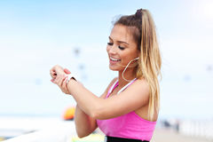 Woman jogging on the beach Royalty Free Stock Photo