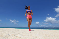 Woman jogging on beach Stock Photography
