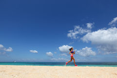 Woman jogging on beach Stock Image