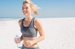 Woman jogging at beach Royalty Free Stock Photos