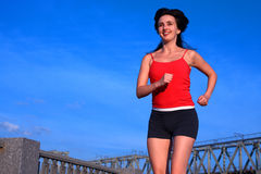 Woman jogging on blue sky uban Stock Photography