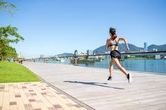 Woman jogging on the boardwalk Stock Photos