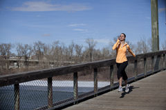 Woman jogging on bridge Royalty Free Stock Photography