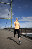 Woman jogging on bridge Royalty Free Stock Photos