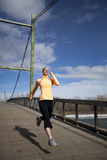 Woman jogging on bridge Royalty Free Stock Images