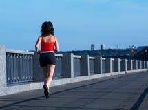 Woman jogging at the bridge Royalty Free Stock Image