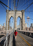 Woman jogging Brooklyn Bridge Royalty Free Stock Images