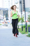 Woman jogging in city street park. Stock Image