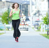 Woman jogging in city street park. Royalty Free Stock Photos