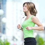 Woman jogging in city street park. Stock Images