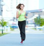 Woman jogging in city street park Stock Photography